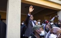 President-elect Hakainde Hichilema (C) waves at supporters after a press briefing at his residence in Lusaka, on 16 August 2021. Zambian business tycoon and veteran opposition leader Hakainde Hichilema scored a landslide victory in bitterly-contested presidential elections. Picture: Patrick Meinhardt/AFP