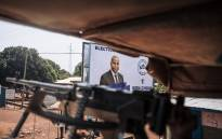 FILE: Egyptian commandos of the United Nations Multidimensional Integrated Stabilisation Mission in the Central African Republic (MINUSCA) patrol in Bangui, the capital of the Central African Republic (CAR), as they pass an election poster of CAR President Faustin Archange Touadera on 25 December 2020. Picture: AFP.