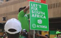 Action SA leader Herman Mashaba hangs a poster during the launch of the party's election campaign on 9 September 2021. Picture: @Action4SA/Twitter.