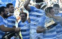Argentina's Los Pumas celebrate after defeating South Africa's Springboks in a Rugby Championship 2018 test match at Malvinas Argentinas stadium in Mendoza, some 1050km west of Buenos Aires, Argentina on 25 August 2018. Picture: AFP