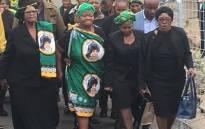 Stompie Seipei's mother Joyce Seipei (C) walks towards late struggle stalwart Winnie Madikizela-Mandela's home on 10 April 2018. Picture: Hitekani Magwedze/EWN