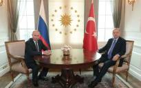 FILE: This handout photo released by the Turkish President's press office shows Turkish President Recep Tayyip Erdogan (R) and Russian President Vladimir Putin (L) posing before their meeting at the Presidential Palace in Ankara, on 16 September 2019. Turkish President Erdogan, Russian President Putin and Iranian President Rouhani are in Ankara for a trilateral meeting for Syria talks. Picture: AFP.