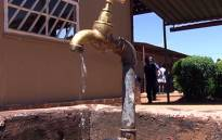 Water runs from a tap. Picture: EWN.