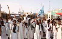 Sudanese protesters gather outside the main entrance to the southern port in Port Sudan on September 20, 2021. Picture: AFP