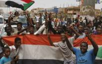 Sudanese people celebrate in the streets of Khartoum after ruling generals and protest leaders announced they have reached an agreement on the disputed issue of a new governing body on 5 July 2019.  Picture: AFP