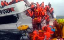 A video screengrab of crew members and passengers rescued from a sinking Robben Island ferry. Picture: EWN