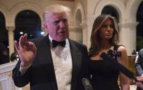 US President-elect Donald Trump answers questions from reporters accompanied by his wife Melania for a New Year's Eve party 31 December, 2016 at Mar-a-Lago in Palm Beach, Florida. Picture: AFP.