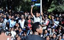 Supporters of Jawar Mohammed, a member of the Oromo ethnic group who has been a public critic of Abiy, gather outside his home in the Ethiopian capital, Addis Ababa after he accused security forces of trying to orchestrate an attack against him October 24, 2019. Picture: AFP.