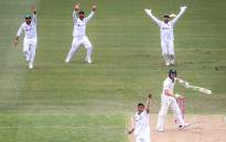 India's Navdeep Saini (L) celebrates after dismissing Australia's Will Pucovski (top R) during the first day of the third cricket Test match between Australia and India at the Sydney Cricket Ground in Sydney on 7 January 2021. Picture: AFP