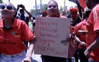 EFF members picket outside the state capture commission of inquiry on 19 November 2018, where Public Enterprises Minister Pravin Gordhan was giving evidence. Picture: Abigail Javier/EWN