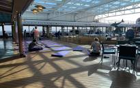 This photo taken and obtained from the Twitter account of Christina Kerby (@ChristinaKerby) on 12 February 2020 shows passengers on yoga mats onboard the US cruise ship Westerdam in the Gulf of Thailand. Picture: AFP
