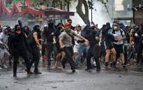Demonstrators protesting against the economic policies of the government of President Sebastian Pinera clash with riot police in Santiago, on 4 November 2019. Picture: AFP