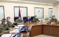 Armenian Prime Minister Nikol Pashinyan meets with top military officials in Yerevan on 27 September 2020. Arch foes Armenia and Azerbaijan on 27 September 2020 accused each other of initiating deadly clashes that claimed at least 23 lives over a decades-long territorial dispute and threatened to draw in regional powers Russia and Turkey. Picture: AFP