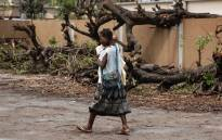 A mother and her baby leave the Central Hospital of Beira after Cyclone Idai swept through the city. Picture: Christa Eybers/EWN.