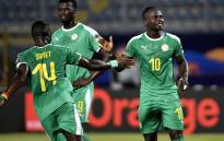 Senegal's midfielder Henri Saivet (L) congratulates forward Sadio Mane (R) on his goal during the 2019 Africa Cup of Nations (CAN) Group C football match between Kenya and Senegal at the 30 June Stadium in the Egyptian capital Cairo on 1 July 2019. Picture: AFP