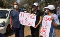 FILE: Healthcare workers gathered outside the home of Dr Abdulhay Munshi in Houghton to express their condolences to the family of the slain doctor and stand in solidarity with healthcare practitioners. Picture: Veronica Mokhoali/EWN