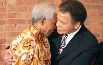 Former South African president Nelson Mandela, enjoying a moment with former boxing champion, Muhammad Ali. Picture: Facebook.