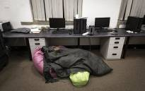 A Wits student sleeps in the postgraduate lab. He is one of 19 students waiting for the Department of Arts and Culture to pay the funds of their promised bursaries. Picture: Sethembiso Zulu/EWN