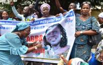 Supporters of Ivory Coast's former first lady, Simone Gbagbo, celebrate in front of her residence in the Riviera neighbourhood of Abidjan holding a poster with Gbagbo's portrait as they wait for her release from prison on 8 August 2018. Picture: AFP