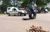 FILE: Demonstrating students and the police have clashed at the University of Pretoria's main entrance, where several students have also been arrested on 19 February 2016. Picture: Barry Bateman/EWN.