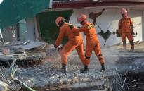 Indonesian search and rescue members look for victims at a mosque that collapsed following a 7.0 magnitude earthquake in Tanjong, North Lombok on 6 August 2018. Picture: AFP