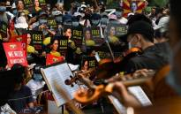 Musicians perform during a demonstration against the military coup in Yangon on 19 February 2021. Picture: AFP