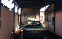 At the alleged gunman's house in Zola, his wife says their children were sitting in a vehicle watching as a group of angry men set their home alight. Picture: Mia Lindeque/EWN.