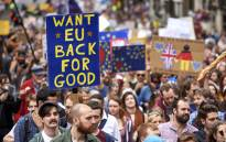 FILE: People hold up pro-Europe placards as thousands of protesters take part in a March for Europe, through the centre of London on July 2, 2016, to protest against Britain's vote to leave the EU. Picture: AFP.