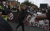 "A protestor calls for the crowd to ""Say Her Name Breonna Taylor"" while marching in downtown Louisville, Kentucky, on 23 September 2020, after a judge announced the charges brought by a grand jury against Detective Brett Hankison, one of three police officers involved in the fatal shooting of Breonna Taylor in March. Picture: AFP"