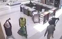 A screengrab from supplied CCTV footage shows a gang of men storming Harris & D'Arcy Jewellers at Cape Town's Blue Route Mall on 11 January 2015.