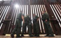 FILE: US Border Patrol agents lock the border wall gate at the conclusion of the Hugs Not Walls event on the US-Mexico border on 13 October 2018 in Sunland Park, New Mexico. Picture: AFP