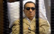 Egyptian president Hosni Mubarak sits inside a cage in a courtroom during his verdict hearing in Cairo on 2 June 2012. Picture: AFP.