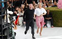 British fashion designer Kim Jones (L), acknowledges the audience at the end of the Dior show during the Men's Spring/Summer 2019 fashion show on 23 June 2018 in Paris. Picture: AFP