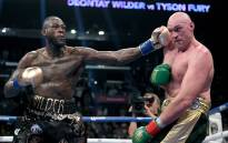 Deontay Wilder punches Tyson Fury during their WBC Heavyweight Championship at Staples Center on 1 December, 2018 in Los Angeles, California. Picture: AFP