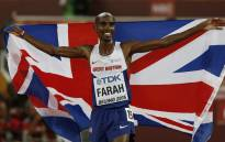 FILE: Britain's Mo Farah celebrates winning the final of the men's 5000 metres athletics event at the 2015 IAAF World Championships at the Bird's Nest National Stadium in Beijing on 29 August 2015. Picture: AFP.