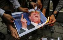 FILE: Iranians burn an image of US President Donald Trump during an anti-US demonstration outside the former US embassy headquarters in the capital Tehran on 9 May 2018 after Trump's withdrawal from the nuclear deal with Iran. Picture: AFP