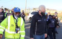 Western Cape Premier Alan Winde (centre) on a patrol with local law enforcement, neighbourhood watch members and SAPS in Delft on 13 October 2020. Picture: @alanwinde/Twitter