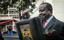 Kenya's Cabinet Secretary for National Treasury Henry Rotich leaves with the budget briefcase for Parliament to read the budget speech for 2018-2019 in Nairobi, Kenya, on 14 June 2018. Picture: AFP