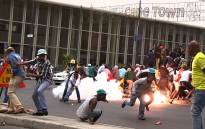 Police use stun grenades to disperse protesting taxi drivers who shut down Strand Street in Cape Town's CBD. Picture: Thomas Holder/EWN