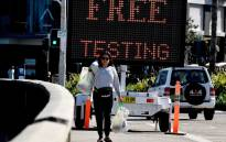 FILE: An electronic screen advertises free COVID-19 testing being offered at Bondi Beach in Sydney on 22 April 2020.  Picture: AFP