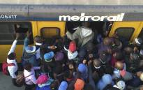 Commuters jostle to get onto a train at Phillipi Station on 20 April 2016. Picture: Xolani Koyana/EWN