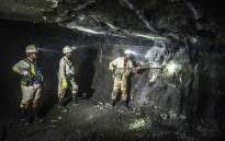 FILE: Miners at work in a shaft. Picture: AFP