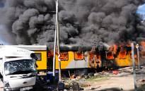 Metrorail train burns after collision with a light vehicle near Stellenbosch. Picture: Gordon Hiles/EWN