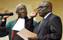 Minister of Mineral Resources Ngoako Ramatlhodi (R) is seen being sworn in as a deputy minister in 2010. Picture: GCIS.