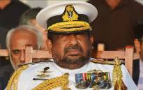This photo taken on 29 August 2018 shows a Sri Lankan Admiral Ravindra Wijegunaratne, Chief of the Defence Staff attends a ceremony commissioning two naval patrol boats Japan gifted the Sri Lankan coastguard, in Colombo. A court on August 29 ordered the arrest of Sri Lanka's top military officer in connection with the abduction and murder of 11 people during the island's civil war. Colombo Fort magistrate Lanka Jayaratne directed police to detain Admiral Ravindra Wijegunaratne, Chief of the Defence Staff, for allegedly helping the main person accused in the killings escape prosecution. Picture: AFP