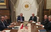 Turkish President Recep Tayyip Erdogan (C-L) and US Vice President Mike Pence (C-R), joined by Secretary of State Mike Pompeo (4R), Turkish Vice President Fuat Oktay (4L), Turkish Foreign Minister Mevlut Cavusoglu (3L) and senior aides, meet at the presidential complex in Ankara, Turkey, on 17 October 2019. Picture: AFP