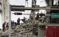 Search and Rescue teams look for possible survivors and to recover remains in the partially collapsed 12-story Champlain Towers South condo building on 29 June 2021 in Surfside, Florida. Picture: Joe Raedle/Getty Images/AFP