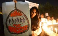 Indian protesters hold candles and posters during a rally in Ahmedabad on December 30, 2012, following following the cremation of a gangrape victim in the Indian capital. Picture: AFP