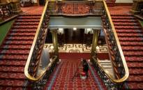 An employee cleans the carpet of the imposing staircase of the Rand Club in Johannesburg, ahead of the annual Christmas dinner party on 6 December 2018. Picture: AFP