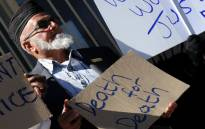"""Muslims demonstrate outside the Krugersdorp Magistrate's Court on Monday, 13 August 2012 where two men, accused of assaulting Muslim men in Magaliesburg appeared. Picture: Sapa."""""""
